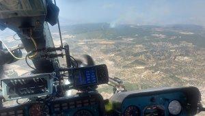 Foça'da ormanlık alanda çıkan yangın kontrol altında